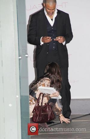 Rick Fox takes a picture of Eliza Dushku's hand Launch of 'The Beauty Book for Brain Cancer' at Grauman's Chinese...