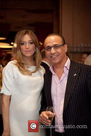 Theo Paphitis with model Jacqui Ainsley attending the launch of new lingerie brand Boux Avenue at Sketch London, England -...