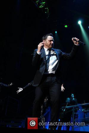 Mikey Graham,  of Boyzone performing in concert at the MEN Arena. Manchester, England - 05.03.11
