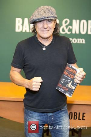Brian Johnson of the band AC/DC  signs his new memoir 'Rockers and Rollers' at Barnes & Noble  New...