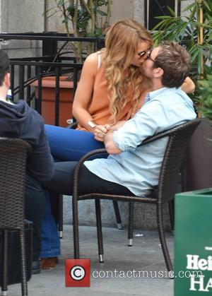 Brian McFadden and Vogue Williams seen kissing outside Harry's Bar where Vogue was filming scenes for the RTE reality show...