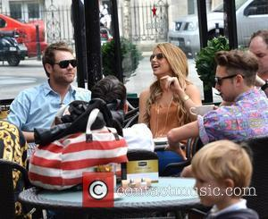 Brian McFadden and Vogue Williams outside Harry's Bar where Vogue was filming scenes for the RTE reality show 'Fade Street'...