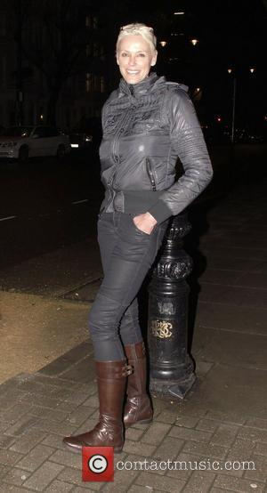 Brigitte Nielsen out and about in South Kensington wearing a hooded coat, tight jeans and boots. London England - 10.02.11