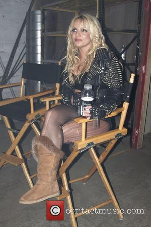Britney Spears  relaxes and rehydrates with a bottle of glaceau vitaminwater after her first big dance number on the...