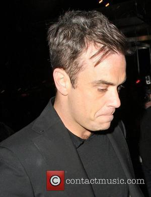 Robbie Williams,  The BRIT Awards 2011 - departing from a boat at the Savoy Pier. London, England - 16.02.11