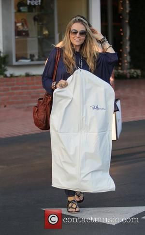 Brooke Mueller leaving Fred Segal in West Hollywood after two hours of shopping, in a change of clothes, and carrying...