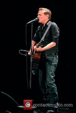 Bryan Adams performs during his 'The Bare Bones Tour' at The Kravis Center  West Palm Beach, Florida - 11.08.11