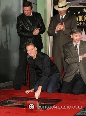 Wayne Gretzky, Bryan Adams and Leron Gubler Bryan Adams receives the 2,435th star on the Hollywood Walk of Fame, held...
