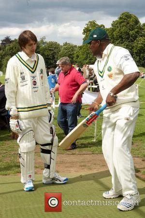 Harry Potter actor Oliver Phelps with Devon Malcolm  Bunbury Celebrity Charity Cricket Match held at Box Hill School Surrey,...