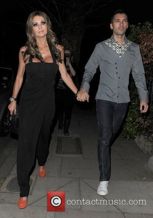 Nicola McLean and her husband Tom Williams arriving at a private party in Chelsea. London, England - 24.03.11