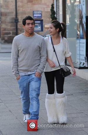 Carlos Tevez and a female companion  after leaving 'Beauty Works' in Alderley Edge  Cheshire, England - 04.03.11