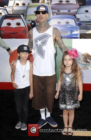 Travis Barker and his children The Los Angeles premiere of 'Cars 2' held at El Capitan Theatre - Arrivals Los...
