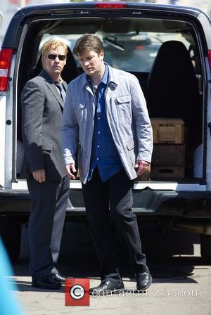 Nathan Fillion films scenes for television show 'Castle' on Santa Monica Pier Los Angeles, California - 28.03.11