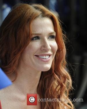 Poppy Montgomery 'Without a Trace' stars at Citi Field to watch the New York Mets game vs Washington Nationals Queens,...