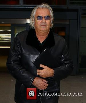 Roberto Cavalli arriving at Heathrow Airport London, England - 01.03.11