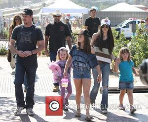 Kevin Dillon and his wife Jane Stuart sending a day at Malibu Fair with their children Los Angeles, California, USA...