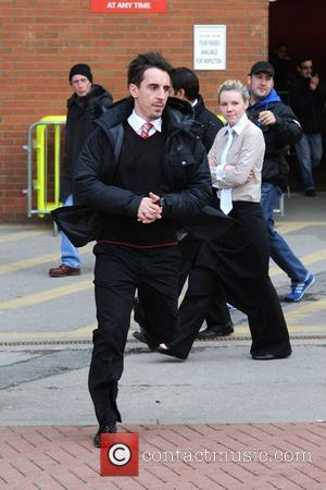 Gary Neville leaving Old Trafford after watching the Premier League derby match between Manchester United and Manchester City. Manchester, England...