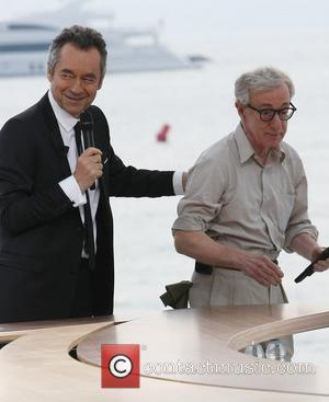 Michel Denisot with Woody Allen  on the french TV show 'Le Grand Journal' during 2011 Cannes International Film Festival...