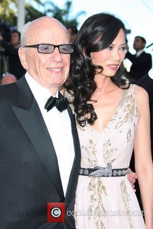 Rupert Murdoch and Wendi Deng 2011 Cannes International Film Festival - Day 6 - The Tree of Life - Premiere...