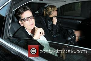Charlie Sheen and Natalie Kenly aka Natty Charlie Sheen continues on his whirlwind media tour as he leaves the Live...