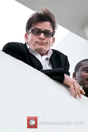 Charlie Sheen  continues on his whirlwind media tour and stops on the roof of the Live Nation office to...
