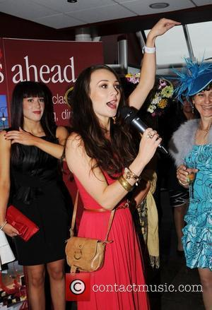 Claire Cooper judges the best dressed lady competition at the Chester Races Chester Races at Chester Racecourse Chester, England -...