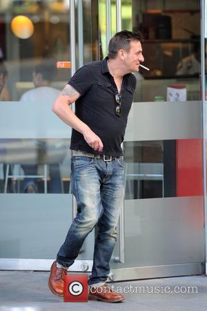 Chris Gascoyne has a cigarette outside Samsi Restaurant Manchester, England - 27.04.11