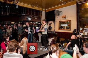 Simon Pegg and Chris Martin of Coldplay perform at Boogaloo. London, England - 13.04.11