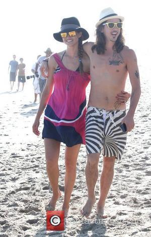 Linda Thompson and Cisco Adler walking along Malibu beach Los Angeles, California - 02.07.11