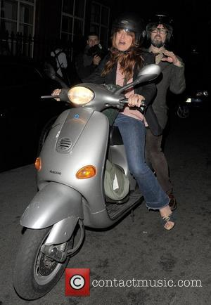 Jarvis Cocker leaves Claridge's Hotel on the back of a Vespa Scooter, driven by a female companion. London, England -...