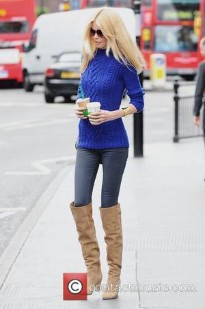Claudia Schiffer grabs a coffee from Starbucks in Notting Hill London, England - 26.05.11