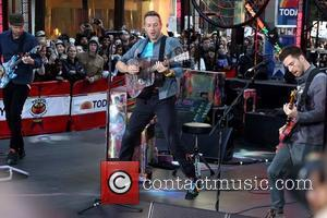 Chris Martin getting some air Coldplay performing on the 'Today' show's Toyota Concert Series at Rockefeller Plaza New York City,...