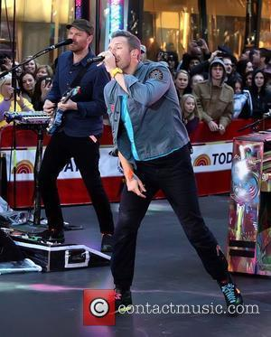 Jonny Buckland and Chris Martin Coldplay performing live on the 'Today' show as part of their Toyota Concert Series at...
