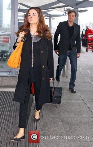 Colin Firth and his wife Livia Giuggioli arriving at the airport London, England - 22.02.11