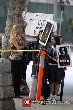 Protestors and La Toya Jackson