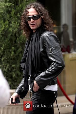 Constantine Maroulis shopping at The Grove in Hollywood wearing a black scarf Los Angeles, California - 07.04.11