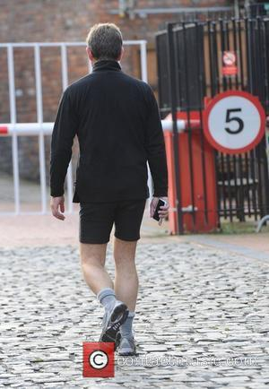 John Michie arrives in in his sport shorts,  arrive at the Coronation Street film set at Granada Studios Manchester,...