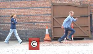Will Thorpe runs away from Samia Smith when spotted by photographers,  at Granada Studios to film 'Coronation Street' Manchester,...