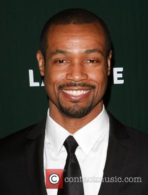 Isaiah Mustafa 13th Annual Costume Designers Guild Awards held at The Beverly Hilton hotel Beverly Hills, California - 22.02.11