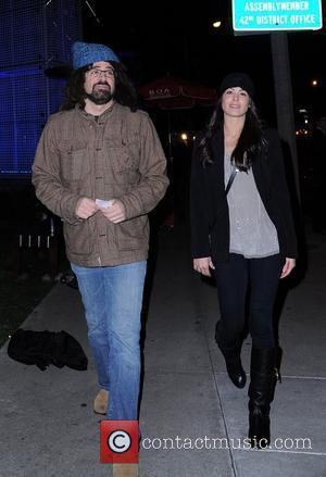 Adam Duritz from the band Counting Crows and a female companion are seen heading to Boa for dinner Los Angeles,...