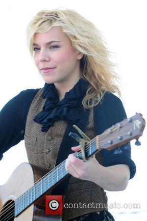 Kimberly Perry from the musical group The Band Perry performing  KISS Country Chili Cookoff at C.B Smith Park...