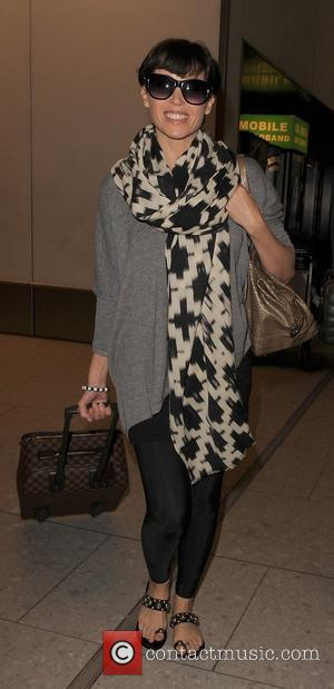 Dannii Minogue  arriving at Heathrow Airport. London, England - 13.09.11