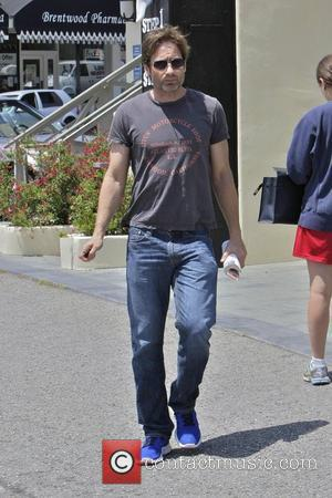 David Duchovny departs the Brentwood Country Mart Los Angeles, California - 11.08.11