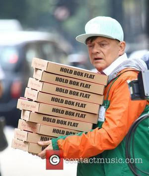 David Jason on the set of 'The Royal Bodyguard' dressed as a pizza delivery man London, England - 19.07.11