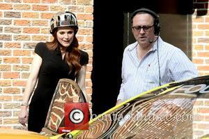 Julianne Moore wearing a helmet as she films a segment outside the Ed Sullivan Theater for 'The Late Show with...