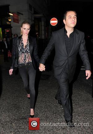David Walliams and Lara Stone holding hands as they walk outside Nobu London, England - 19.04.11