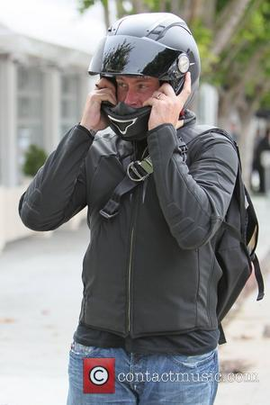 Dean McDermott leaving the Fig and Olive restaurant on his Triumph motorcycle after having lunch with his wife Tori Spelling,...