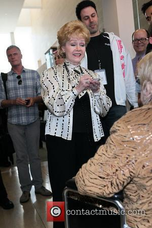 Debbie Reynolds  inside the Paley Center in Beverly Hills greeting members of the public viewing her Legendary Film Memorabilia...