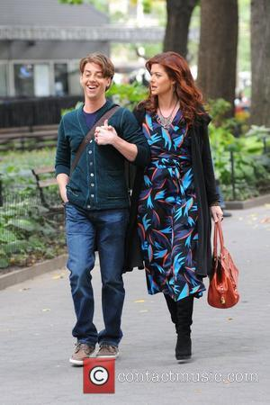 Debra Messing and Christian Borle film the new series 'Smash' in Madison Square Park in New York City New York...