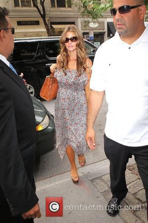Denise Richards is seen entering the Christian Louboutin boutique on Madison Avenue New York City, USA - 28.07.11